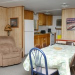 wood paneled kitchen and dining room