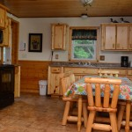 kitchen wit log chairs and cabinets