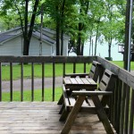 chairs on deck with lake in background
