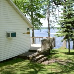 view of cabin and the lake