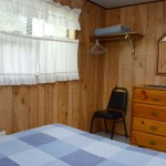 wood paneled retro bedroom