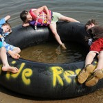 kids laying on inner-tube